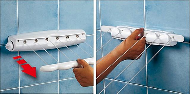 Такой инерционный блок не портит интерьера помещения, и позволяет быстро натянуть веревки для белья